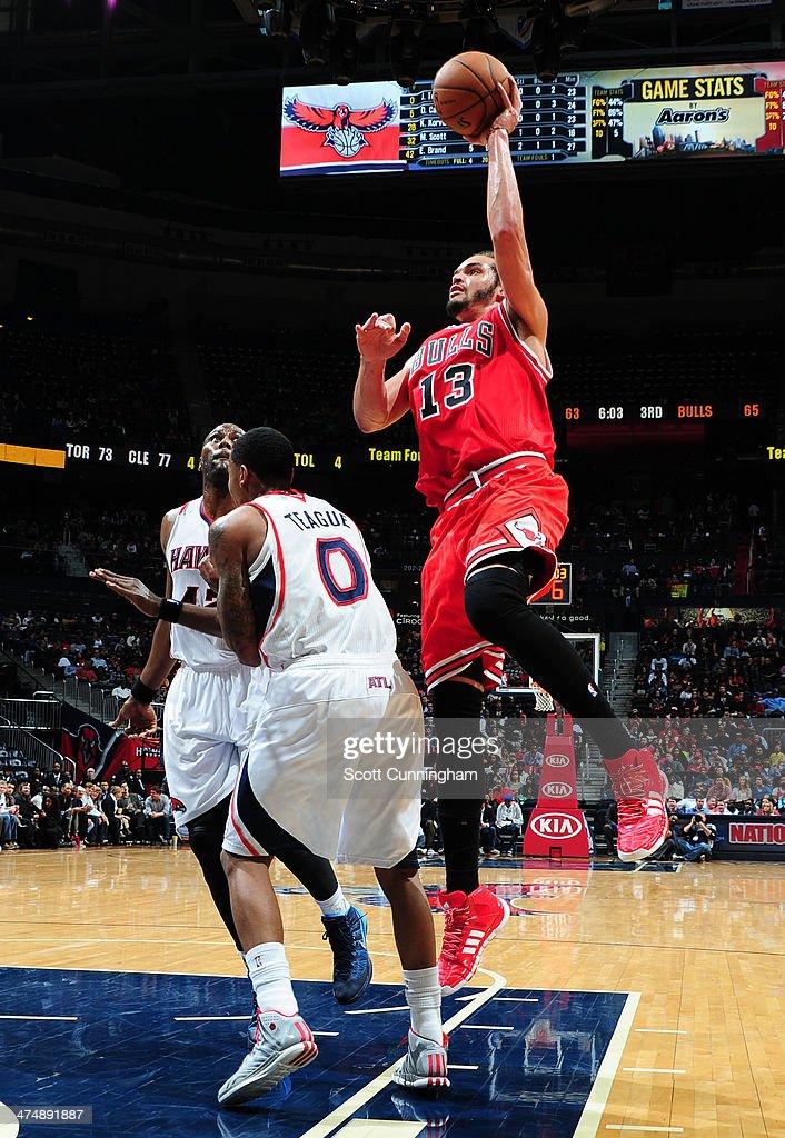 Joakim Noah #13 of the Chicago Bulls shoots against the Atlanta Hawks on February 25, 2014 at Philips Arena in Atlanta, Georgia.