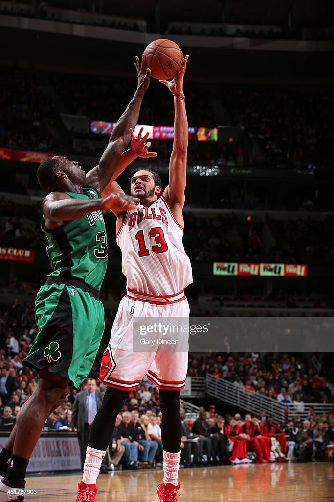 Joakim Noah #13 of the Chicago Bulls shoots against the Boston Celtics on March 31, 2014 at the United Center in Chicago, Illinois.
