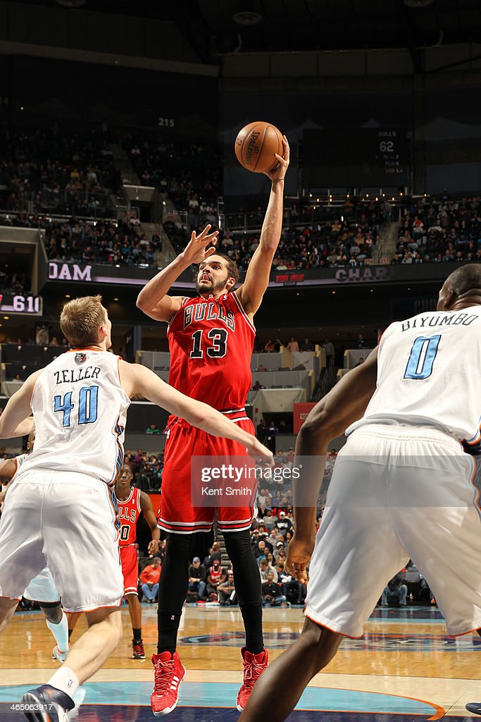 <a gi-track='captionPersonalityLinkClicked' href=/galleries/search?phrase=Joakim+Noah&family=editorial&specificpeople=699038 ng-click='$event.stopPropagation()'>Joakim Noah</a> #13 of the Chicago Bulls shoots against the Charlotte Bobcats during the game at the Time Warner Cable Arena on January 25, 2014 in Charlotte, North Carolina.