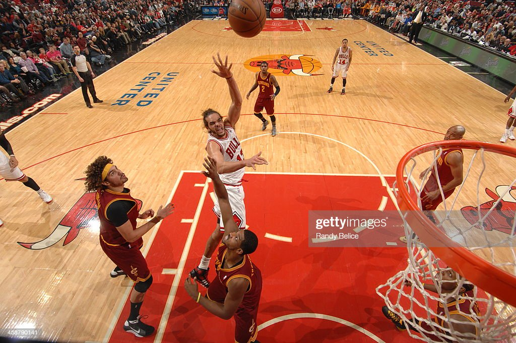 <a gi-track='captionPersonalityLinkClicked' href=/galleries/search?phrase=Joakim+Noah&family=editorial&specificpeople=699038 ng-click='$event.stopPropagation()'>Joakim Noah</a> #13 of the Chicago Bulls shoots against the Cleveland Cavaliers on December 21, 2013 at the United Center in Chicago, Illinois.