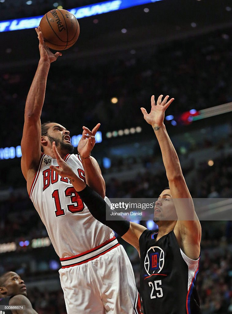 <a gi-track='captionPersonalityLinkClicked' href=/galleries/search?phrase=Joakim+Noah&family=editorial&specificpeople=699038 ng-click='$event.stopPropagation()'>Joakim Noah</a> #13 of the Chicago Bulls shoots over <a gi-track='captionPersonalityLinkClicked' href=/galleries/search?phrase=Austin+Rivers&family=editorial&specificpeople=7117574 ng-click='$event.stopPropagation()'>Austin Rivers</a> #25 of the Los Angeles Clippers at the United Center on December 10, 2015 in Chicago, Illinois. The Bulls defeated the Clippers 83-80.