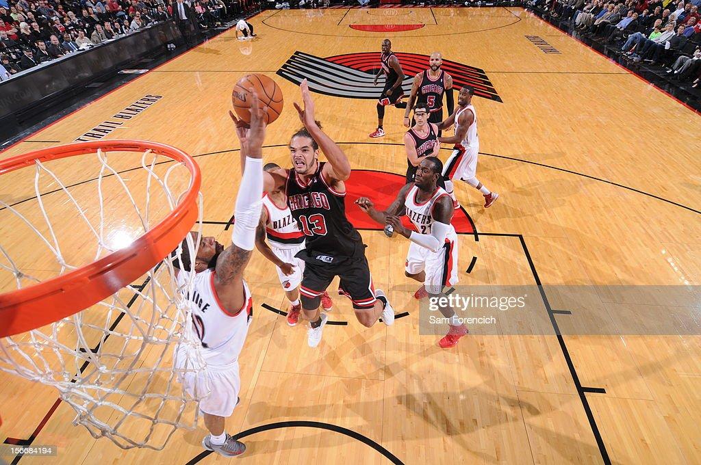 Joakim Noah #13 of the Chicago Bulls shoots the ball against LaMarcus Aldridge #12 of the Portland Trail Blazers on November 18, 2012 at the Rose Garden Arena in Portland, Oregon.