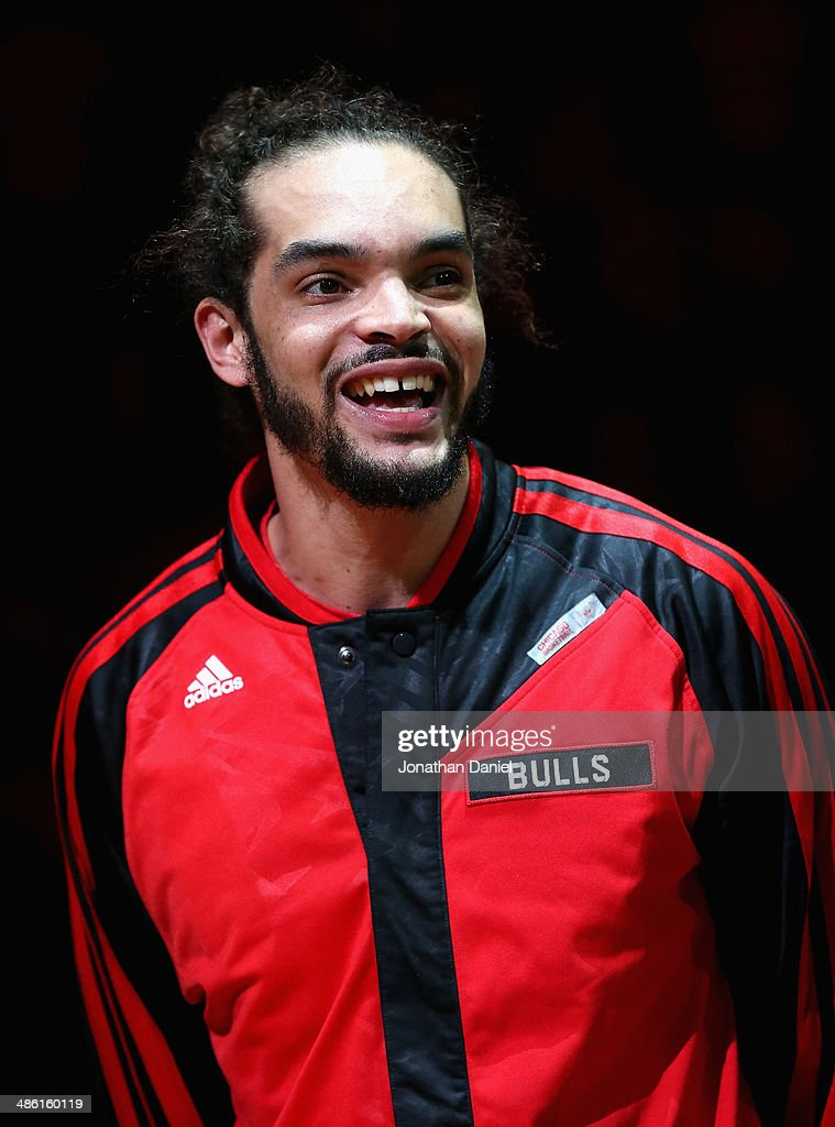 <a gi-track='captionPersonalityLinkClicked' href=/galleries/search?phrase=Joakim+Noah&family=editorial&specificpeople=699038 ng-click='$event.stopPropagation()'>Joakim Noah</a> #13 of the Chicago Bulls smiles as he accepts the 2013-1014 NBA Defensive Player of the Year trophy before Game Two of the Eastern Conference Quarterfinals during the 2014 NBA Playoffs against the Washington Wizards at the United Center on April 22, 2014 in Chicago, Illinois.