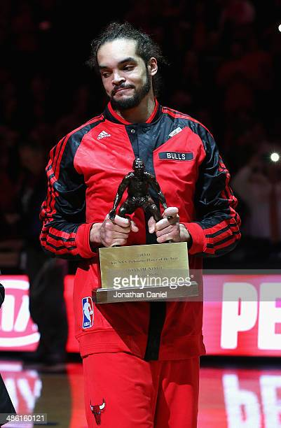 Joakim Noah of the Chicago Bulls smiles as he accepts the 20131014 NBA Defensive Player of the Year trophy before Game Two of the Eastern Conference...