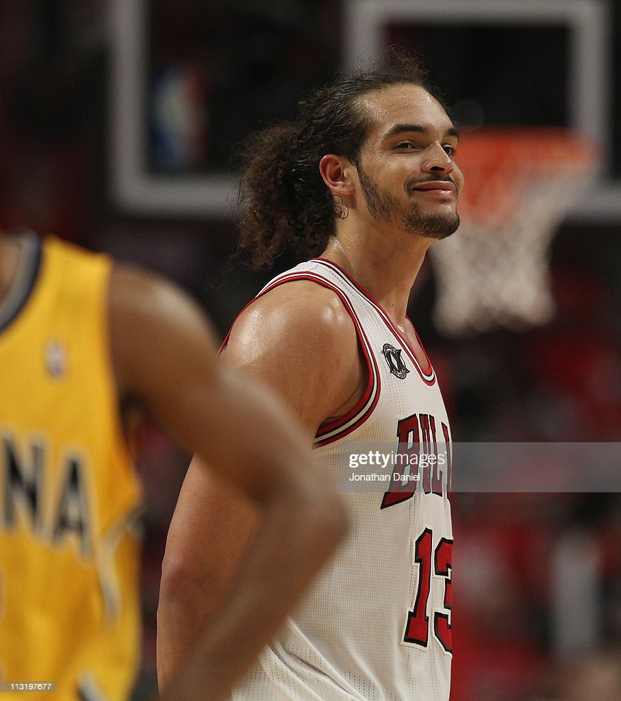 <a gi-track='captionPersonalityLinkClicked' href=/galleries/search?phrase=Joakim+Noah&family=editorial&specificpeople=699038 ng-click='$event.stopPropagation()'>Joakim Noah</a> #13 of the Chicago Bulls smiles at family in the stands near the end of a win over the Indiana Pacers in Game Five of the Eastern Conference Quarterfinals in the 2011 NBA Playoffs at the United Center on April 26, 2011 in Chicago, Illinois. The Bulls defeated the Pacers 116-89.