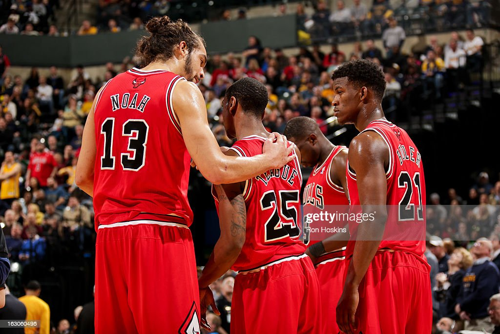<a gi-track='captionPersonalityLinkClicked' href=/galleries/search?phrase=Joakim+Noah&family=editorial&specificpeople=699038 ng-click='$event.stopPropagation()'>Joakim Noah</a> #13 of the Chicago Bulls speaks with teammates <a gi-track='captionPersonalityLinkClicked' href=/galleries/search?phrase=Marquis+Teague&family=editorial&specificpeople=7621183 ng-click='$event.stopPropagation()'>Marquis Teague</a> #25 and <a gi-track='captionPersonalityLinkClicked' href=/galleries/search?phrase=Jimmy+Butler+-+Basketball+Player&family=editorial&specificpeople=9860567 ng-click='$event.stopPropagation()'>Jimmy Butler</a> #21 before resuming play against the Indiana Pacers on March 3, 2013 at Bankers Life Fieldhouse in Indianapolis, Indiana.