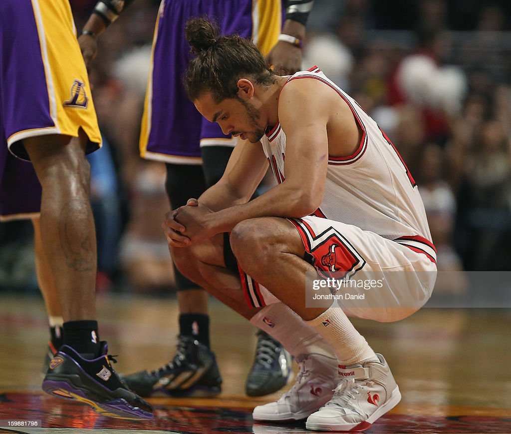 Joakim Noah #13 of the Chicago Bulls takes a moment to himself before the opening tip against the Los Angeles Lakers at the United Center on January 21, 2013 in Chicago, Illinois. The Bulls defeated the Lakers 95-83.