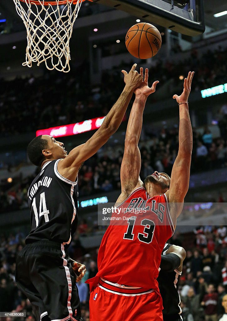 <a gi-track='captionPersonalityLinkClicked' href=/galleries/search?phrase=Joakim+Noah&family=editorial&specificpeople=699038 ng-click='$event.stopPropagation()'>Joakim Noah</a> #13 of the Chicago Bulls tries to control a rebound against <a gi-track='captionPersonalityLinkClicked' href=/galleries/search?phrase=Shaun+Livingston&family=editorial&specificpeople=202955 ng-click='$event.stopPropagation()'>Shaun Livingston</a> #14 of the Brooklyn Nets at the United Center on February 13, 2014 in Chicago, Illinois. The Bulls defeated the Nets 92-76.