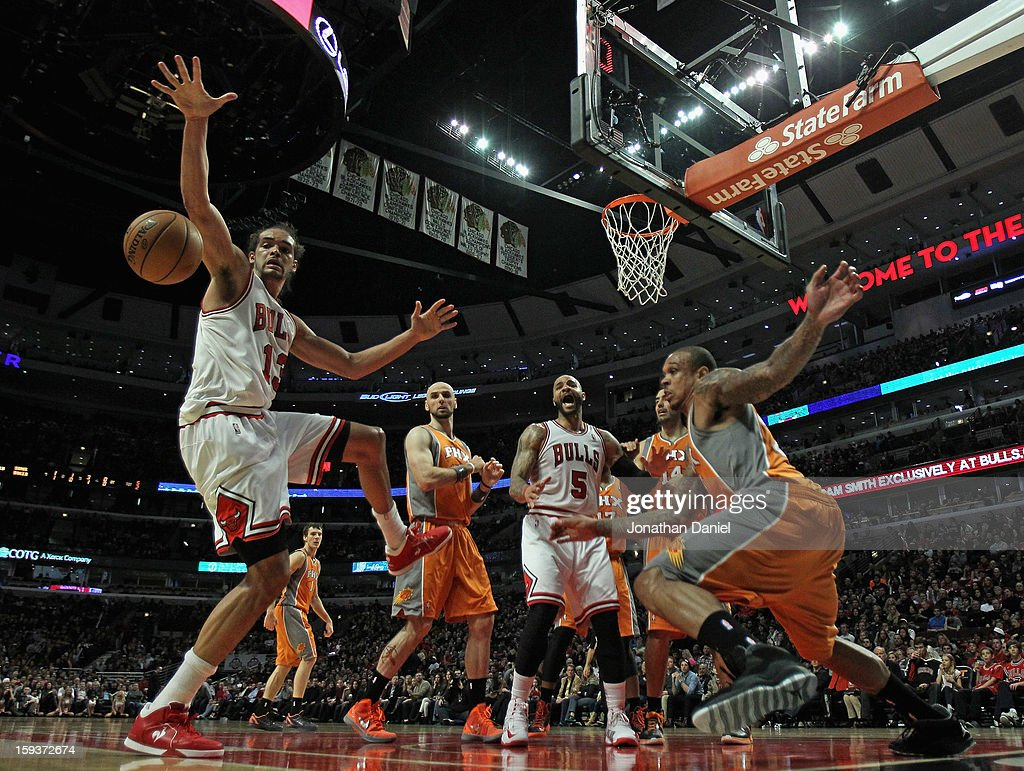 Joakim Noah #13 of the Chicago Bulls tries to control a rebound as Shannon Brown #26 of the Phoenix Suns (R) breaks to the ball at the United Center on January 12, 2013 in Chicago, Illinois. The Suns defeated the Bulls 97-81.