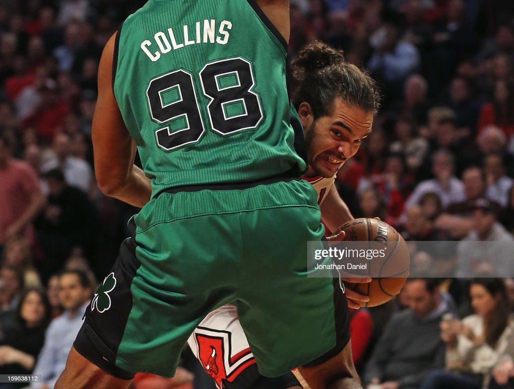 Joakim Noah #13 of the Chicago Bulls tries to move against Jason Collins #98 of the Boston Celtics at the United Center on December 18, 2012 in Chicago, Illinois. The Bulls defeated the Celtics 100-89.