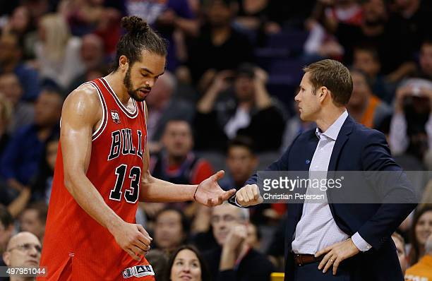 Joakim Noah of the Chicago Bulls walks past head coach Fred Hoiberg as he checks out during the NBA game against the Phoenix Suns at Talking Stick...