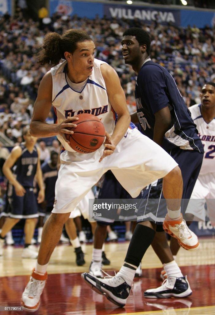 Joakim Noah of the Florida Gators grabs a rebound against the Georgetown Hoyas during their Minneapolis Regional Semifinal of the 2006 NCAA Divison I...