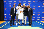 Joakim Noah poses with New York Knicks President Phil Jackson General Manager Steve Mills and Head Coach Jeff Hornacek at a press conference at the...