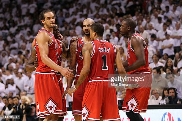 Joakim Noah Ronnie Brewer Carlos Boozer Derrick Rose and Luol Deng of the Chicago Bulls huddle up against the Miami Heat in Game Four of the Eastern...