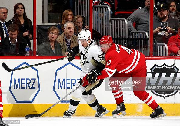 Joakim Nordstrom of the Carolina Hurricanes and Sidney Crosby of the Pittsburgh Penguins battle to control the puck along the boards during an NHL...