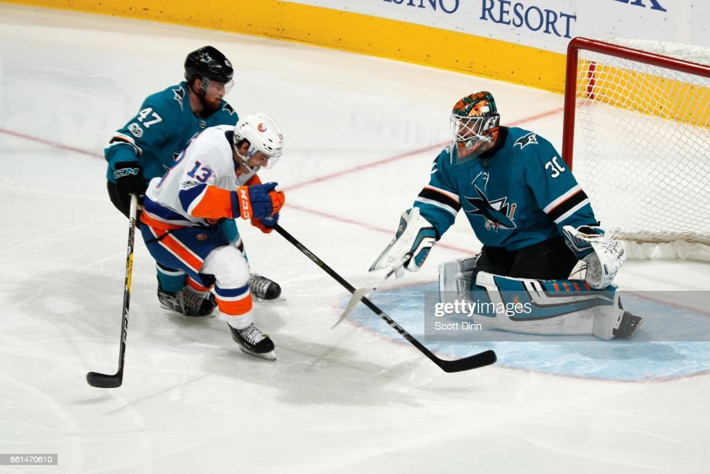 Joakim Ryan #47 and Aaron Dell #30 of the San Jose Sharks defend the net against Mathew Barzal #13 of the New York Islanders at SAP Center on October 14, 2017 in San Jose, California.