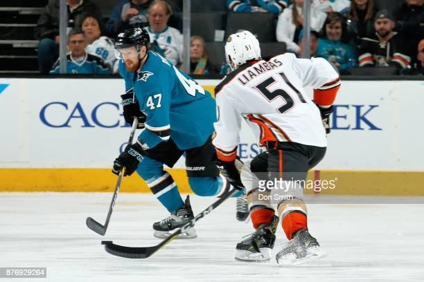 Joakim Ryan of the San Jose Sharks skates against Mike Liambas of the Anaheim Ducks at SAP Center on November 20 2017 in San Jose California