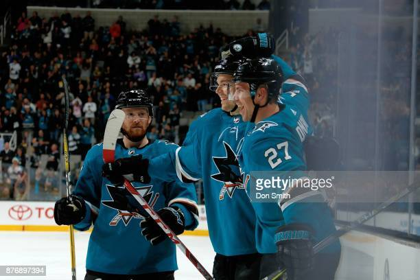 Joakim Ryan Tomas Hertl and Joonas Donskoi of the San Jose Sharks react after Donskoi scores a first period goal during a game against the Anaheim...