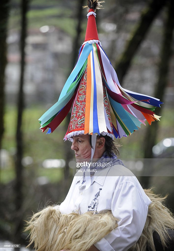 A 'Joalduna' ('that who plays the bell') marches carrying big cowbells tied to her back during the ancient carnival of Zubieta, in the northern Spanish province of Navarra province, on January 28, 2014. The yearly three day festivities, revolving mainly around agriculture and principally sheep hearding, run on the last Sunday, Monday and Tuesday of January where Navarra Valley locals from three villages dress up and participate in a variety of activites as they perform a pilgrimage through each village.