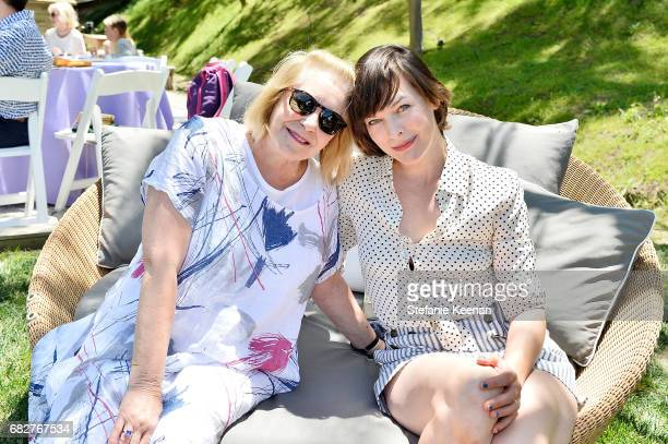 Joan Anderson and Milla Jovovich attend Cindy Crawford and Kaia Gerber host Best Buddies Mother's Day Brunch in Malibu CA sponsored by David Yurman...