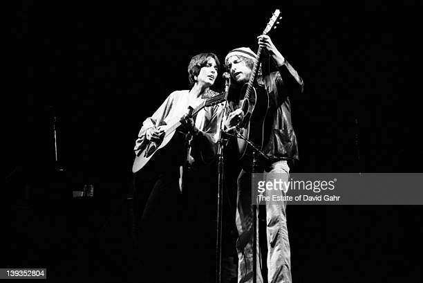 Joan Baez and Bob Dylan perform together as part of Bob Dylan's legendary Rolling Thunder Revue in May 1976 in Houston Texas