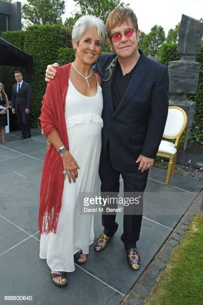 Joan Baez and Sir Elton John attend the Woodside Gallery Dinner in benefit of Elton John AIDS Foundation in partnership with BVLGARI at Woodside on...