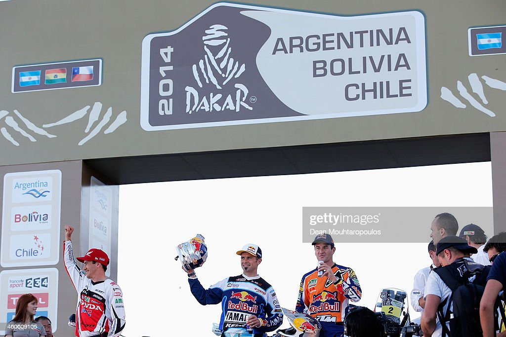 Joan Barreda Bort (L) of Spain Honda HRC Rally Team, (#1) <a gi-track='captionPersonalityLinkClicked' href=/galleries/search?phrase=Cyril+Despres&family=editorial&specificpeople=2092881 ng-click='$event.stopPropagation()'>Cyril Despres</a> (C) of France for the Yamaha Factory Racing team and (#2) <a gi-track='captionPersonalityLinkClicked' href=/galleries/search?phrase=Marc+Coma&family=editorial&specificpeople=767761 ng-click='$event.stopPropagation()'>Marc Coma</a> (R) of Spain for the KTM Red Bull Rally Factory Team shake pose on the official podium in front of The National Flag Memorial (Monumento Nacional a la Bandera) during the 2014 Dakar Rally Previews on January 4, 2014 in Rosario, Argentina.
