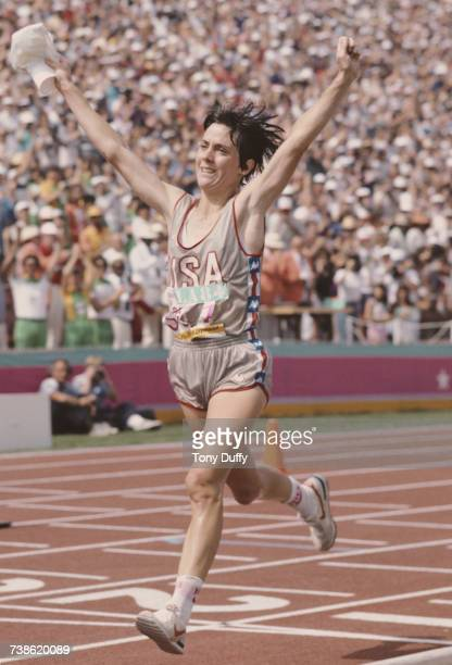 Joan Benoit of the United States raises her arms in celebration after winning the Women's marathon event at the XXIII Olympic Summer Games on 5...