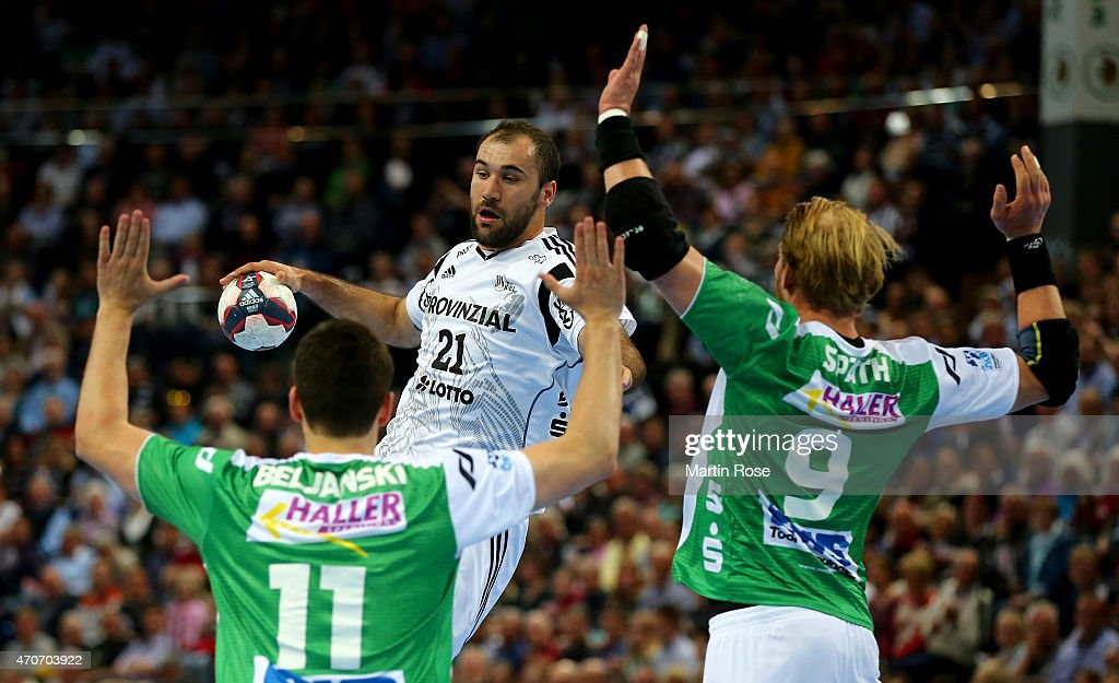 Joan Canellas (C) of Kiel challenges for the ball with Bojan Beljanski #11 and Manuel Spaeth #9 of Goeppingen during the DKB HBL Bundesliga match between THW Kiel and Frisch Auf Goeppingen at Sparkassen Arena on April 22, 2015 in Kiel, Germany.