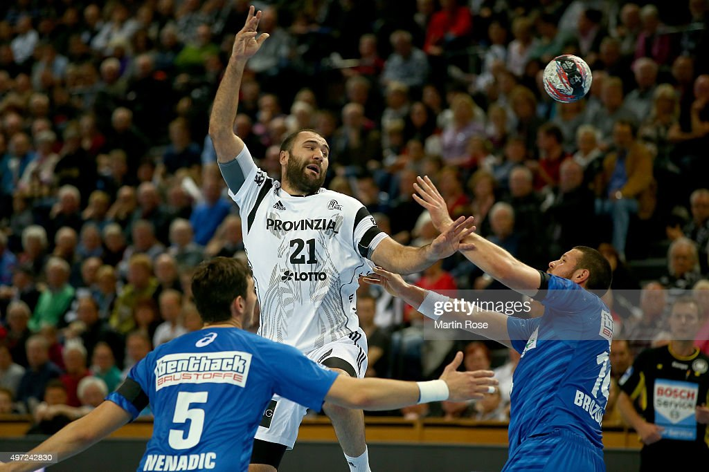 Joan Canellas (C) of Kiel challenges for the ball with Ilija Brozovic #14 and Drasko Nenadic #5 of HSV Handball during the DKB HBL Bundesliga match between THW Kiel and HSV Handball at Sparkassen Arena on November 15, 2015 in Kiel, Germany.