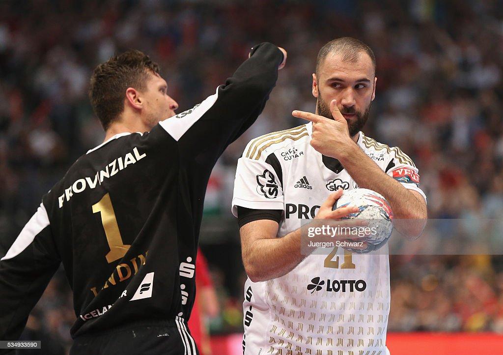 Joan Canellas of Kiel (R) gestures beside goalkeeper Niklas Landin Jacobsen of Kiel during the second semi-final of the EHF Final4 between THW Kiel and MVM Veszprem on May 28, 2016 in Cologne, Germany.