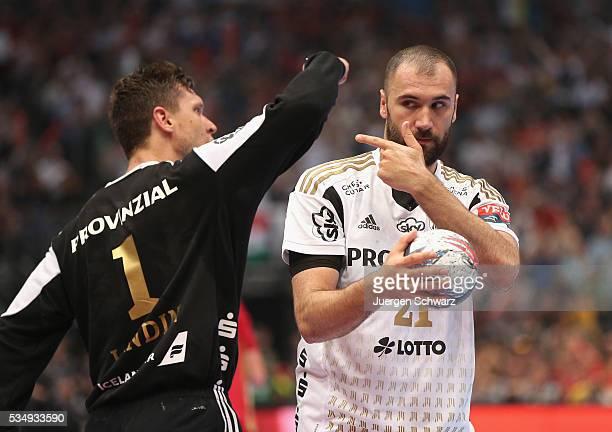 Joan Canellas of Kiel gestures beside goalkeeper Niklas Landin Jacobsen of Kiel during the second semifinal of the EHF Final4 between THW Kiel and...