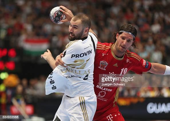 Joan Canellas of Kiel is blocked by Laszlo Nagy of Veszprem during the second semifinal of the EHF Final4 between THW Kiel and MVM Veszprem on May 28...