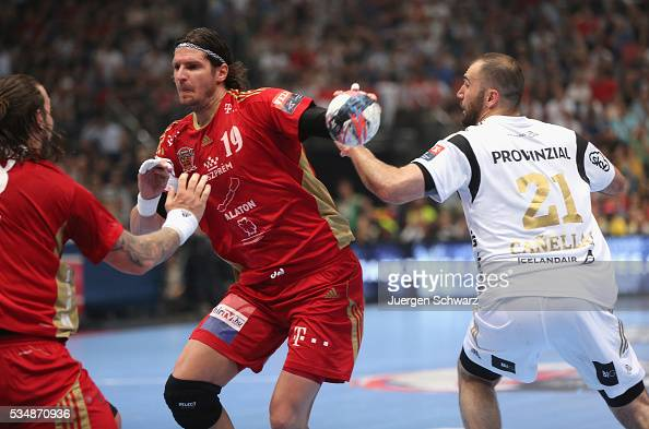 Joan Canellas of Kiel tackles Laszlo Nagy of Veszprem during the second semifinal of the EHF Final4 between THW Kiel and MVM Veszprem on May 28 2016...