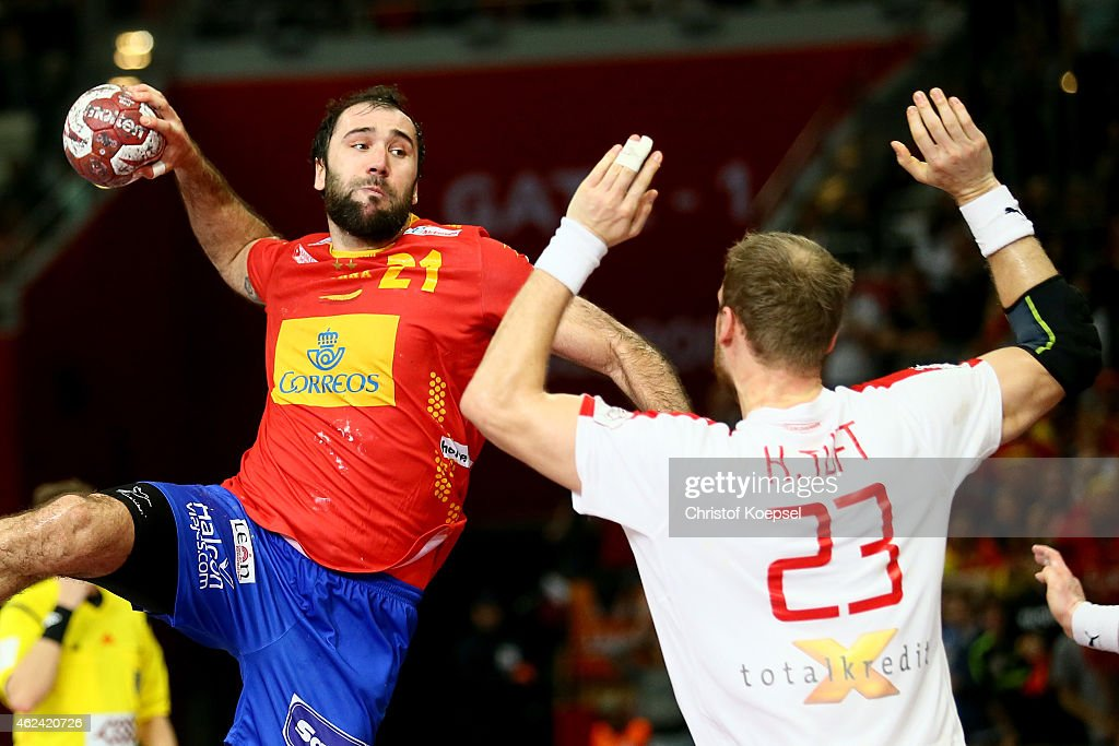 Joan Canellas of Spain scores the decision goal against Henrik Toft of Denmark during the quarter final match between Spain and Denmark at Lusail Multipurpose Hall on January 28, 2015 in Doha, Qatar. The match between Denmark and Spain ended 24-25.