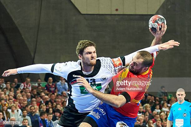 Joan Canellas of Spain throws against Hendrik Pekeler of Germany during the Men's EHF Handball European Championship 2016 match between Spain and...