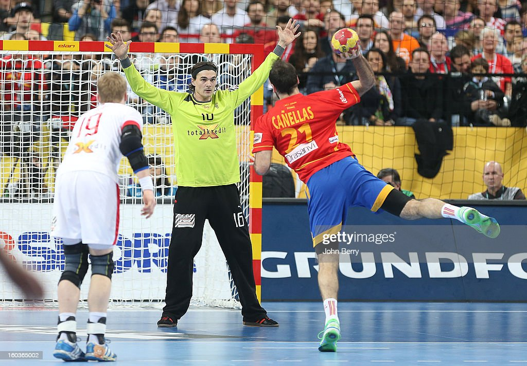 Joan Canellas of Spain tries to score a penalty to Jannick Green, goalkeeper of Denmark during the Men's Handball World Championship 2013 final match between Spain and Denmark at Palau Sant Jordi on January 27, 2013 in Barcelona, Spain.