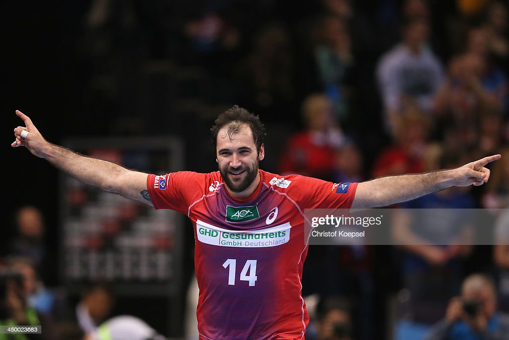 Joan Canellas Reixach of Hamburg celebrates during the VELUX EHF Handball Champions League group D match between HSV Hamburg and SG Flensburg-Handewitt at O2 World Hamburg on November 16, 2013 in Hamburg, Gernmany. The match between Hamburg and Flensburg-handewitt ended 32-27.