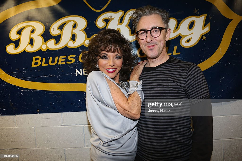 <a gi-track='captionPersonalityLinkClicked' href=/galleries/search?phrase=Joan+Collins&family=editorial&specificpeople=109065 ng-click='$event.stopPropagation()'>Joan Collins</a> and <a gi-track='captionPersonalityLinkClicked' href=/galleries/search?phrase=Alan+Cumming&family=editorial&specificpeople=202521 ng-click='$event.stopPropagation()'>Alan Cumming</a> attend B.B. King Blues Club & Grill on November 5, 2013 in New York City.