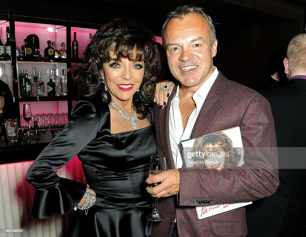 Joan Collins (L) and Graham Norton attend the launch of Joan Collins new book 'Passion For Life' at No.41 Mayfair Club at The Westbury Hotel on October 21, 2013 in London, England.