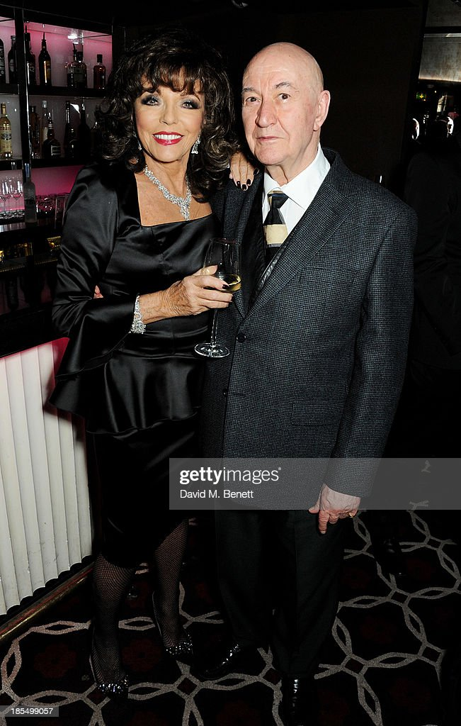 Joan Collins (L) and guest attend the launch of Joan Collins new book 'Passion For Life' at No.41 Mayfair Club at The Westbury Hotel on October 21, 2013 in London, England.
