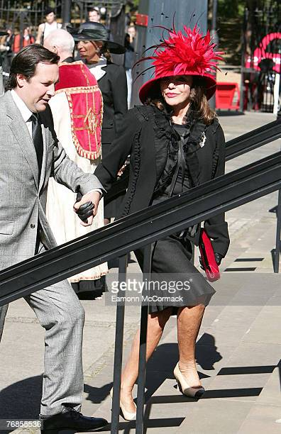 Joan Collins and husband Percy Gibson attend the Isabella Blow Memorial Service at Guards Chapel on September 18 2007 in London England