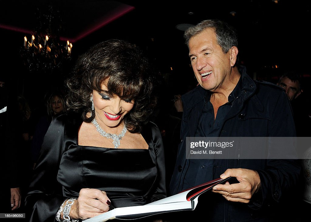Joan Collins (L) and Mario Testino attend the launch of Joan Collins new book 'Passion For Life' at No.41 Mayfair Club at The Westbury Hotel on October 21, 2013 in London, England.