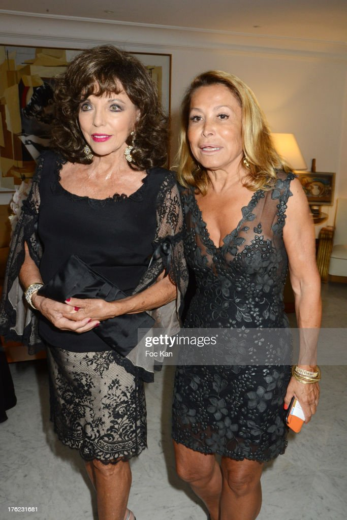 Joan Collins and Mrs Richard Roizen attend the Massimo Gargia's Party hosted by Richard Roizen at Villa Les Acanthes In Saint-Tropez on August 11, 2013 in Saint Tropez, France.
