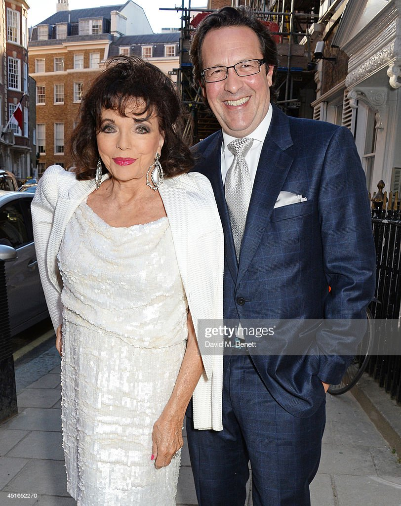 <a gi-track='captionPersonalityLinkClicked' href=/galleries/search?phrase=Joan+Collins&family=editorial&specificpeople=109065 ng-click='$event.stopPropagation()'>Joan Collins</a> (L) and <a gi-track='captionPersonalityLinkClicked' href=/galleries/search?phrase=Percy+Gibson&family=editorial&specificpeople=207140 ng-click='$event.stopPropagation()'>Percy Gibson</a> attend The Spectator Summer Party at Spectator House on July 3, 2014 in London, England.