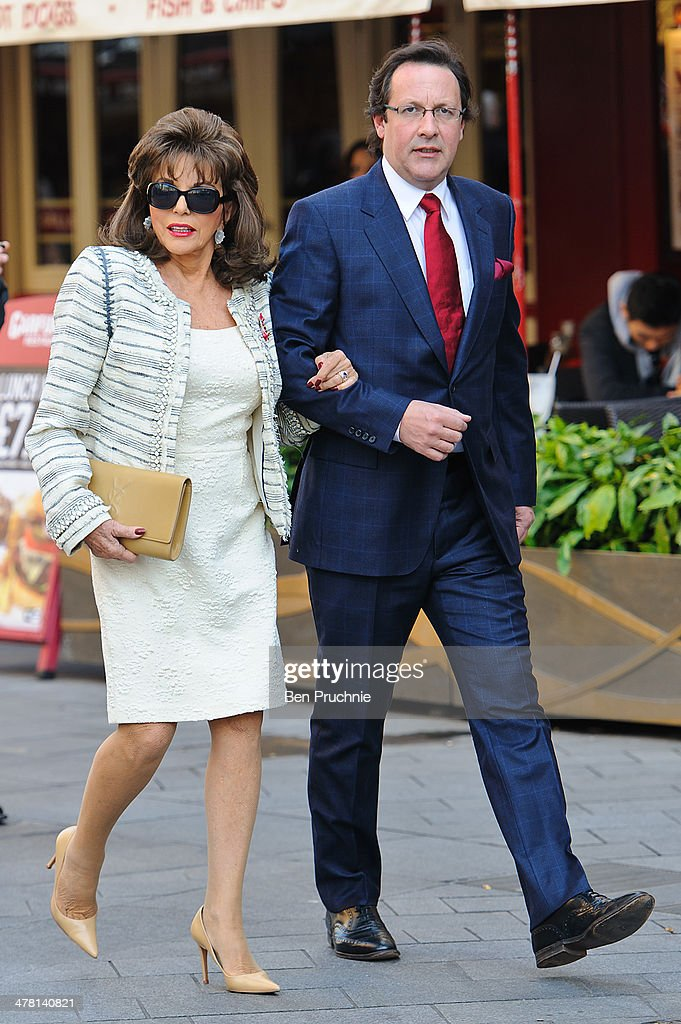 Joan Collins and Percy Gibson sighted in Leicester Square on March 12, 2014 in London, England.