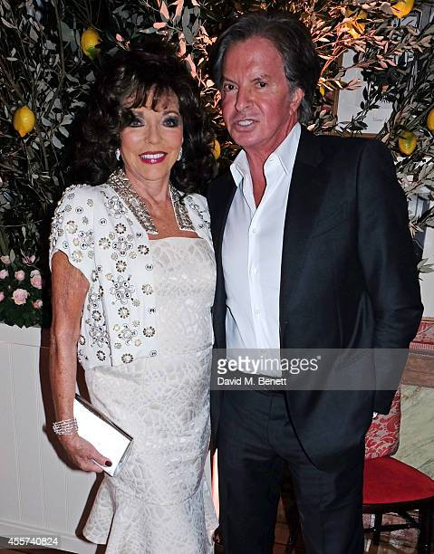Joan Collins and Richard Caring attend the 35th Birthday of Harry's Bar on September 19 2014 in London England