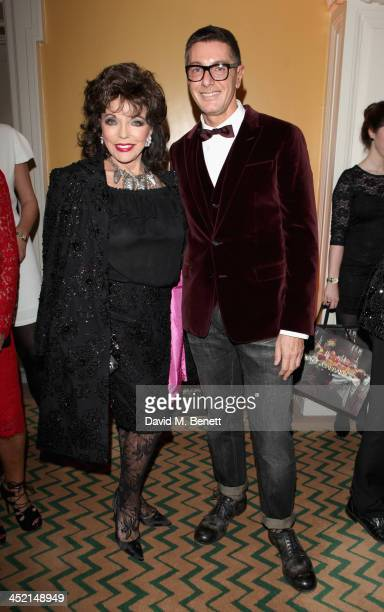 Joan Collins and Stefano Gabbana attend Claridge's Christmas Tree By Dolce Gabbana launch party at Claridge's Hotel on November 26 2013 in London...