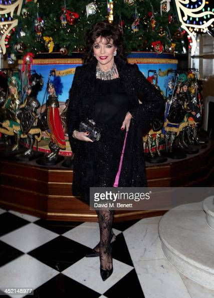 Joan Collins attends Claridge's Christmas Tree By Dolce Gabbana launch party at Claridge's Hotel on November 26 2013 in London England