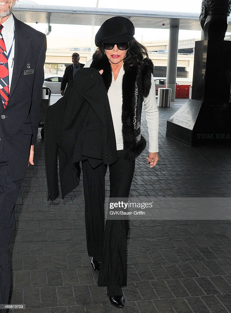 Joan Collins is seen at LAX airport on January 29, 2014 in Los Angeles, California.